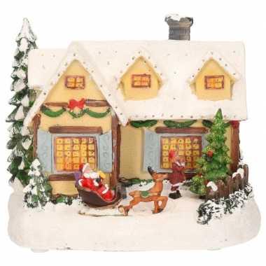 Kerstdorp geel kersthuisje met kerstman 19 cm